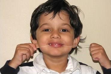 Boy flossing