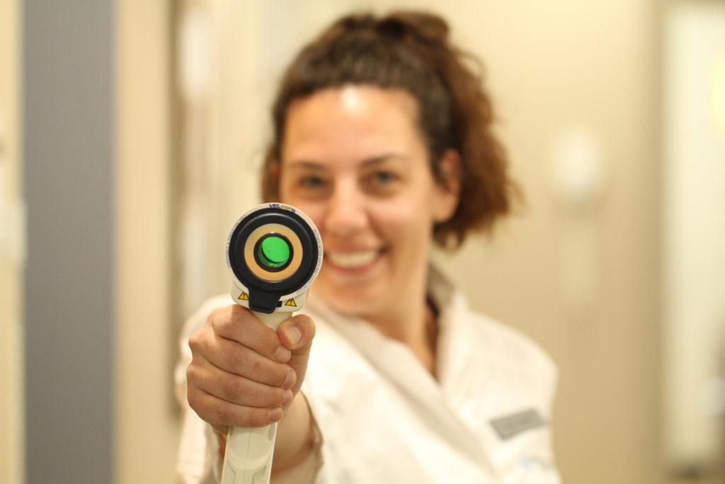 Lady using VELscope.